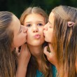 Teenage girl kissed on the cheeks — Stock Photo