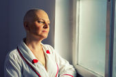 Bald woman cancer patient in the hospital — Stock Photo