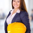Young female architect posing with hard hat — Stock Photo #34958607