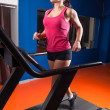 Beautiful girl running in the gym — Stock Photo