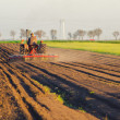 tractor plowing the agricultural field — Stock Photo