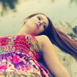 Beautiful girl lying on the tree — Stock Photo