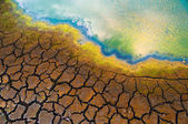 Polluted water and cracked soil — Stock Photo