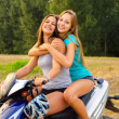 Two beautiful girls enjoying motorcycle ride — Stock Photo