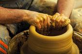 Craftsman making vase on pottery wheel — Stock Photo