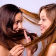 Beautiful girls playing with their hair — Stock Photo