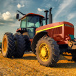 Tractor on the agricultural field — Stock Photo #36780951