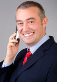 Smiling businessman talking on the phone — Foto de Stock