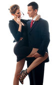Beautiful sexy lady seducing young businessman — Stock Photo