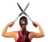 Female gardener cutting with gardening scissors — Stock Photo