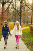 Two teenage girls walking in the park — Foto Stock