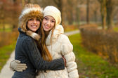 Two beautiful girls having fun outdoor — Stock Photo