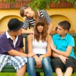 Teenagers consoling and supporting their girlfriend — Stock Photo #38861603