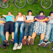 Stock Photo: Resting teenagers after bicycle ride