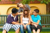 Teenagers consoling and supporting their girlfriend — Stock Photo