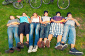 Resting teenagers after bicycle ride — Photo