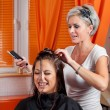 Hairdresser and her client having fun — Stock Photo