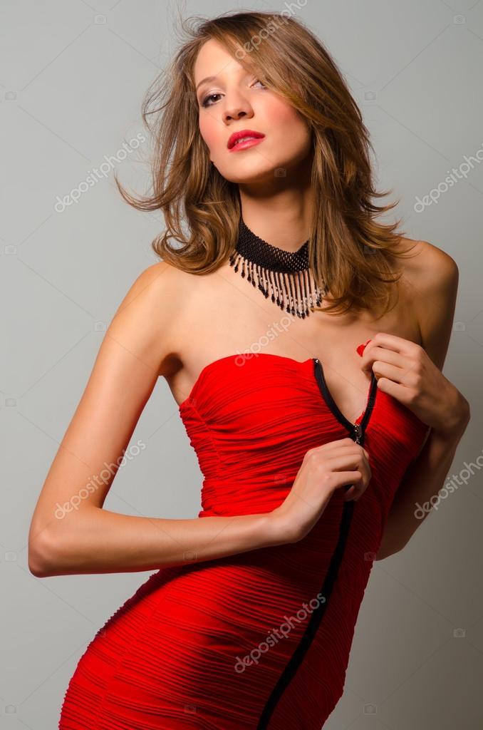 Fashion beauty unzipping red dress � Stock Photo � prudkov #39025297