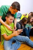 Teenagers using their mobile phones — Foto Stock