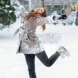 Happy teenage girl dancing in the snow — Stock Photo