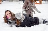 Three teenage girls having fun in the snow — Stockfoto