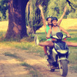 Stockfoto: Two teenage girls riding motorcycle