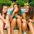 Three teenage girls and one ice cream — Stock Photo