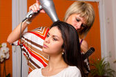 Girl making hair in hairdressing salon — Stock Photo