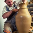 Craftsman making huge vase on pottery wheel — Stock Photo