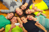 Teenage friends having fun on the floor — Stock Photo