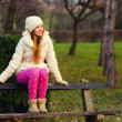 Beautiful girl sitting in the park — Stock Photo #41853323