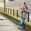 Lonely teenage girl standing outdoor on cold winter day — Stock Photo #41960455