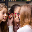 Teenage girlfriends having fun while putting make up — Stock Photo