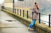Lonely teenage girl standing outdoor on cold winter day — Stock Photo