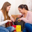 Stock Photo: Girls having fun after shopping