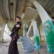 Beautiful fashion model posing in abandoned building — Stock Photo #43713415