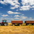 Modern tractor on the agricultural field — Stock Photo