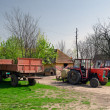 Tractors and trailers on the old fashioned farm — Stock Photo #44170965