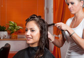 Hairdresser making hair of beautiful girl — Stock Photo
