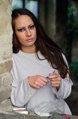 Young female drug addict preparing to take heroin — Stock Photo