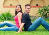 Young happy couple having fun in the garden — Stock Photo