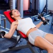 Beautiful fitness girl lifting weights in the gym — Stock Photo #50718351