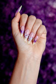 Beautiful purple manicure — Stock Photo