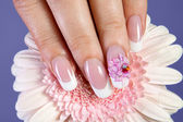 Beautiful manicure with flower design — Stock Photo