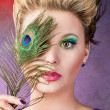 Portrait with a peacock feather — Stock Photo