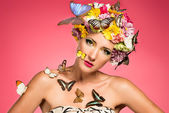 Beautiful woman with floral headpiece — Stock Photo