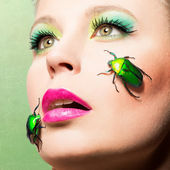 Beautiful femal face with beetles — Stock Photo