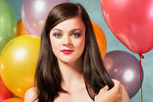 Beautiful woman with balloons — Stock Photo