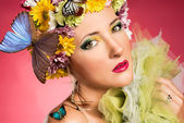 Beautiful woman with butterflies — Stock Photo