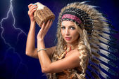 Beautiful woman in native American headpiece — Stock Photo